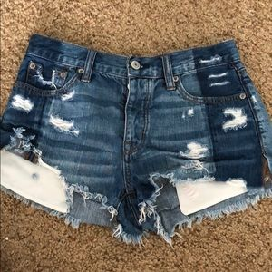 Two tone distressed jean shorts
